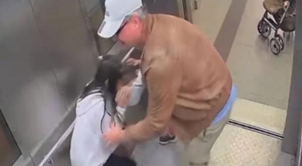 Disturbing video shows Police employee groping 13-year-old girl in an elevator.